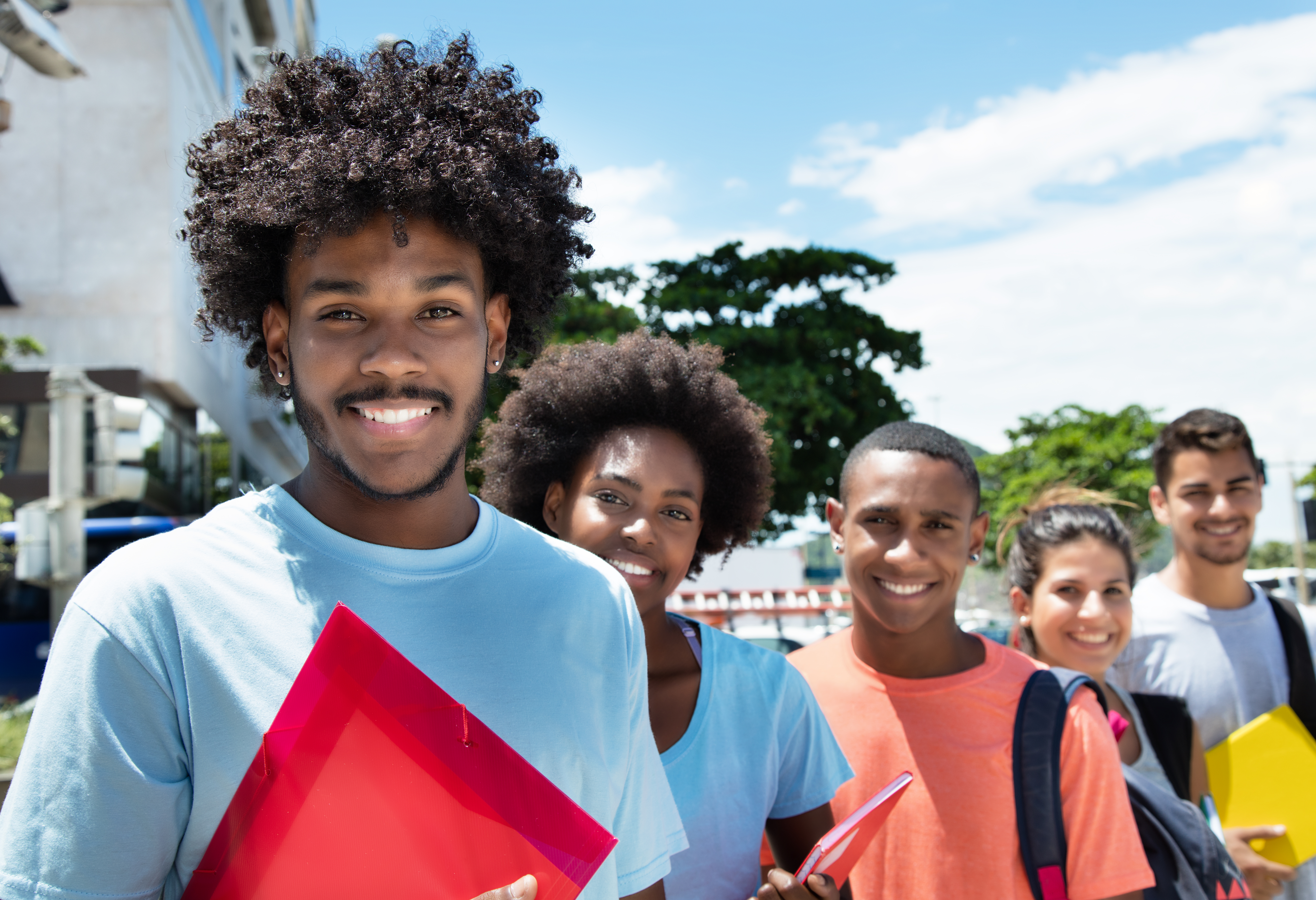 Group of multi-racial students smiling at camera