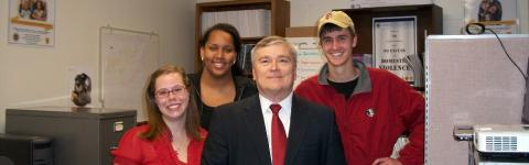 FSU President Eric Barron meets with students at the Institute for Family Violence Studies.