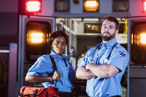 Two EMS professionals posing for picture